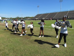 Youth cheer group at the Peanut Bowl