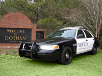Dothan Police patrol car in front of Dothan Police sign