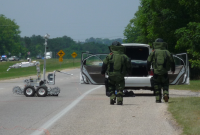 Two bomb squad officers with bomb robot